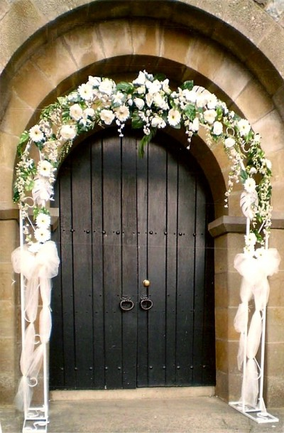 Floral Archway around Chapel entrance by Flowers by Hughes Florist Shop, Monaghan Town, Ireland